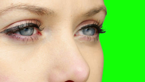 Pretty girl wearing eyeliner looking and blinking Stock Video Footage
