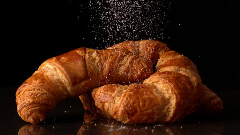 Powdered sugar sprinkling onto croissants Stock Video Footage