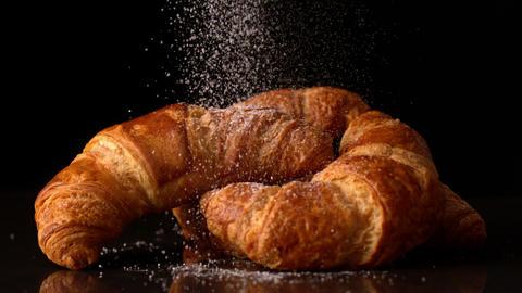 Powdered sugar sprinkling onto croissants Footage