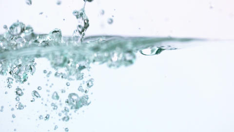 Bubbles rising in water on white background Stock Video Footage