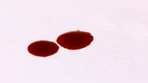 Blood dropping on white surface Stock Video Footage