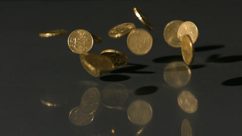 Euro coins falling onto black surface Footage
