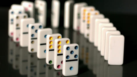 Finger pushing over colourful dominoes Stock Video Footage