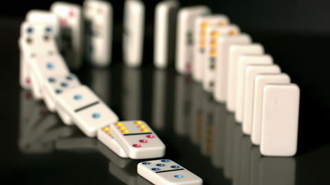 Finger pushing over colourful dominoes Footage