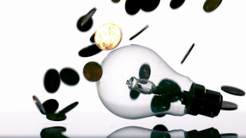 Euro coins falling into light bulb Stock Video Footage