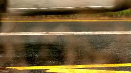 Van driving over wet road Stock Video Footage