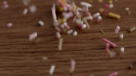 Colourful sprinkles pouring onto surface Footage