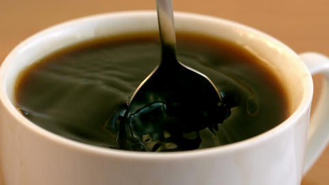 Teaspoon stirring coffee in a cup Stock Video Footage