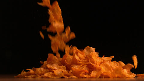 Cereal flakes pouring on black background Footage