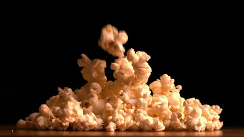 Popcorn pouring on black background Stock Video Footage