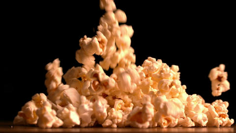 Popcorn pouring on black background Footage