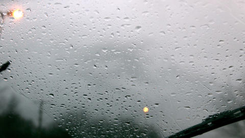 Windscreen wiper wiping rain away from car window Stock Video Footage