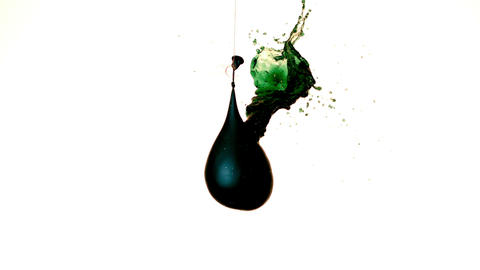 Balloon pouring green liquid from hole Stock Video Footage