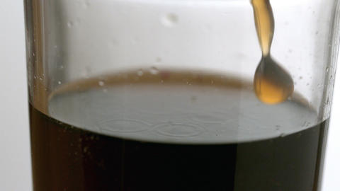 Soda pouring into a glass Stock Video Footage