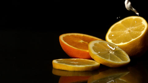 Whipped cream pouring onto orange slices Stock Video Footage
