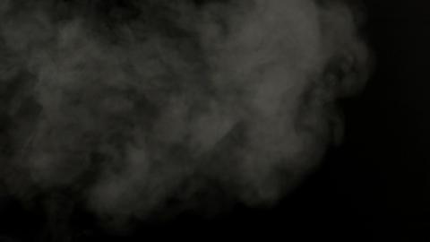 Smoke blowing against black background Footage