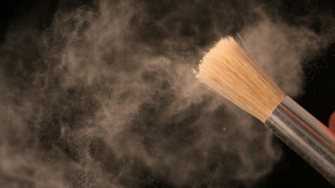 Woman shaking make up brush Stock Video Footage