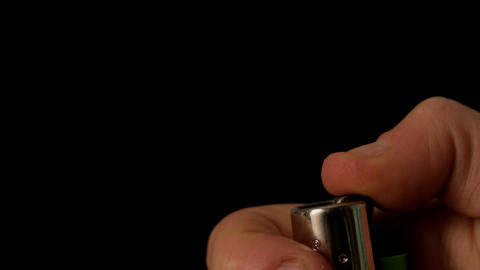 Hand lighting a lighter on black background Stock Video Footage