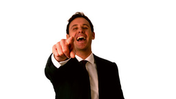 Happy businessman laughing and pointing to camera Stock Video Footage
