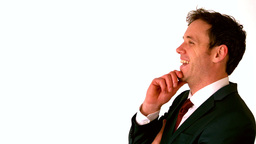 Happy businessman laughing with hand on chin Footage
