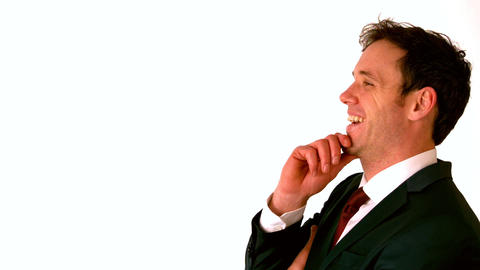 Happy businessman laughing with hand on chin Stock Video Footage