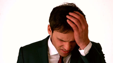 Businessman with headache touching his head Footage