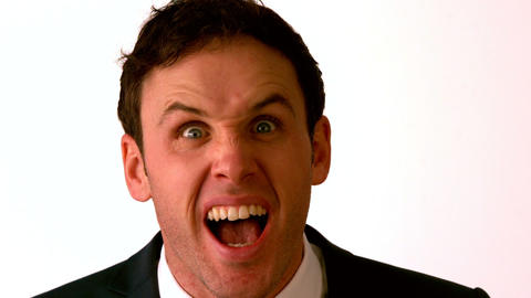 Angry businessman shouting at camera Stock Video Footage