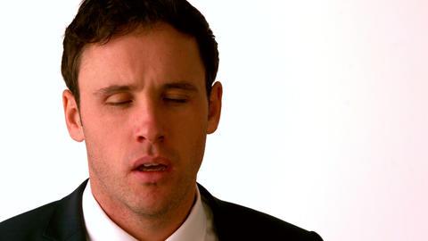 Businessman sneezing on white background Stock Video Footage