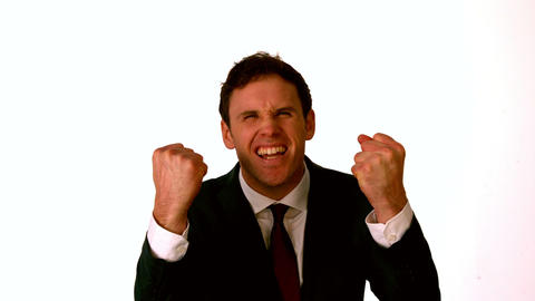 Businessman cheering on white background Stock Video Footage