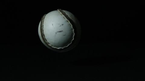 Sliothar falling on black background Stock Video Footage