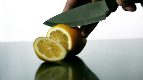 Man slicing lemon with large knife Stock Video Footage