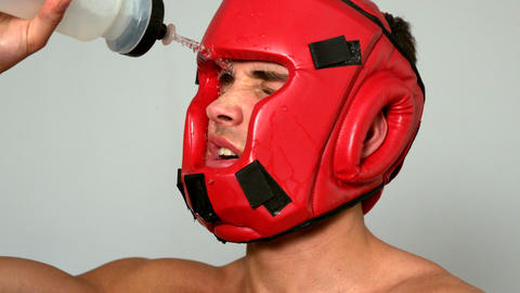 Tough boxer pouring water over his face Footage
