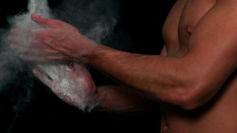 Sportsman clapping his hands with talc Footage