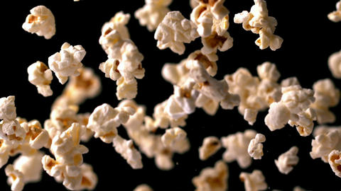 Popcorn bouncing against black background Live Action
