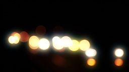 Car Headlights at Night. Defocused Footage