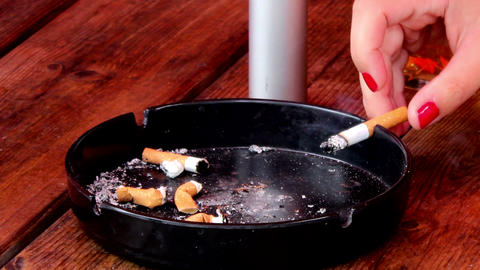 Smoldering cigarette in ashtray Footage