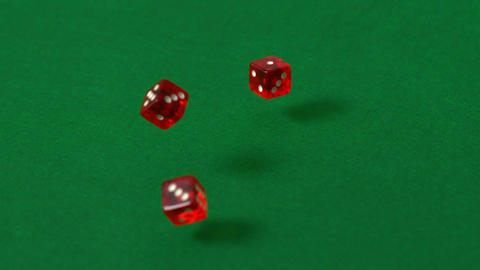 Red dice falling and bouncing Footage