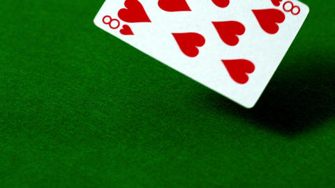Eight of hearts falling on casino table Live Action
