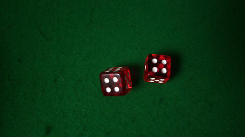 Red dice falling on casino table Footage