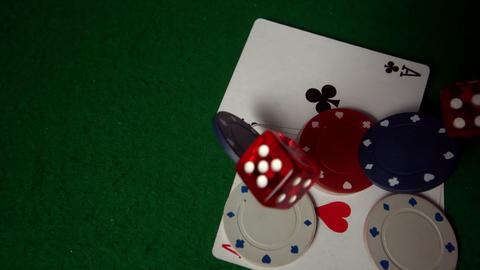 Cards chips and dice falling on casino table Footage