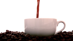 Hot Coffee Pouring Into White Cup stock footage