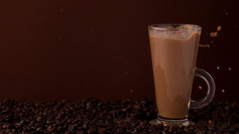 Sugar pouring into glass of coffee Footage