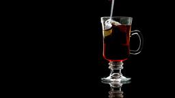 Spoon stirring tea in a glass Footage