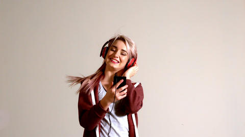 Sporty blonde listening to music with smartphone Footage
