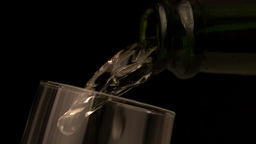 Champagne pouring into flute on black background Footage