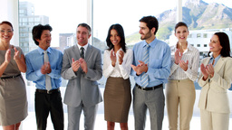 Business team standing in a row clapping at camera Footage