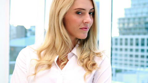 Pretty blonde businesswoman smiling at camera Footage