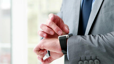 Businessman using his smart watch Footage