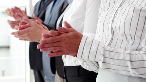 Business team standing in a line clapping Footage