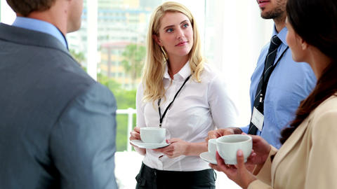 Business people standing at conference drinking coffee Footage